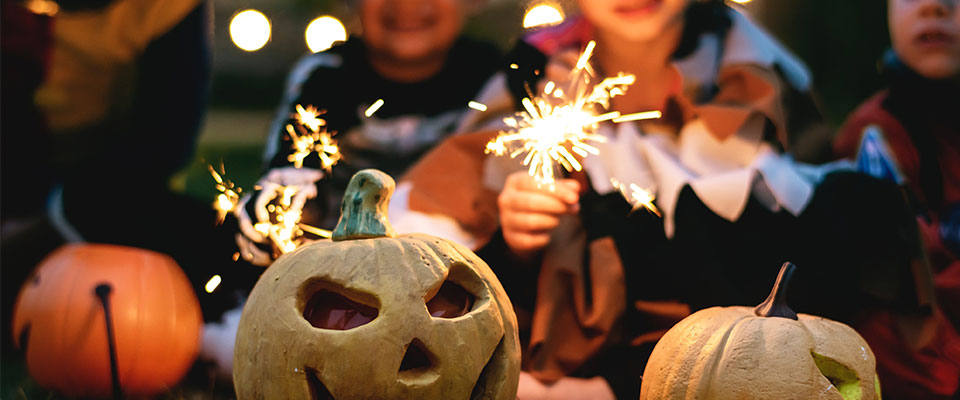 Children with sparklers and Pumpkins