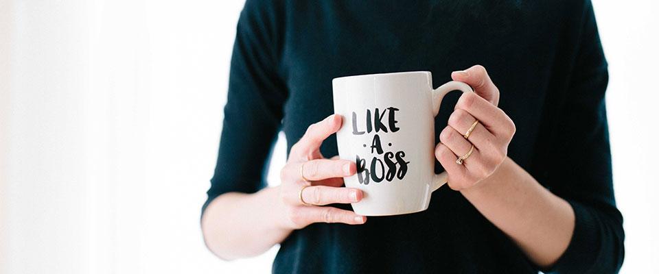 a woman with a mug that says like a boss